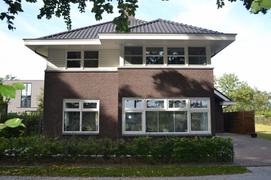 nieuwbouw vrijstaand herenhuis met garage bouwen in stijl